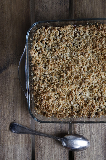 A crumble dish on a dark wooden background