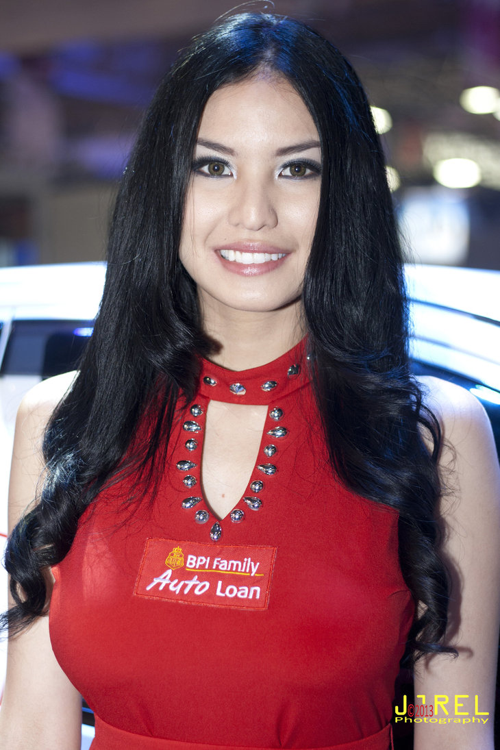 Abby with her BPI family loan auto loan beautiful red dress