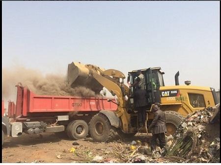 Minister of Environment, Amina Mohammed Drives Bulldozer During Sanitation in Abuja (Photos)