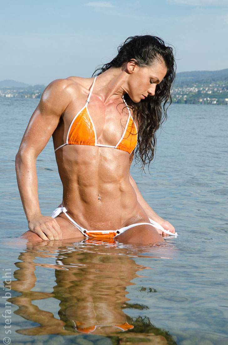 Cindy Landolt Models Her Shredded Abs In An Orange Bikini