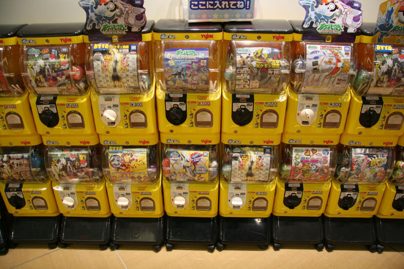 Gashapon In Yellow Dispensers By Tostzilla