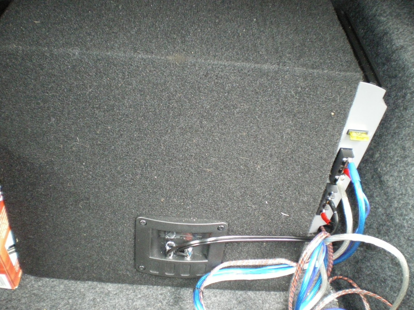 ... I mounted my Amp and Sub on the Subwoofer box. I made this choice  because I wanted the option of removing my Amp and Sub if I needed more  trunk space.