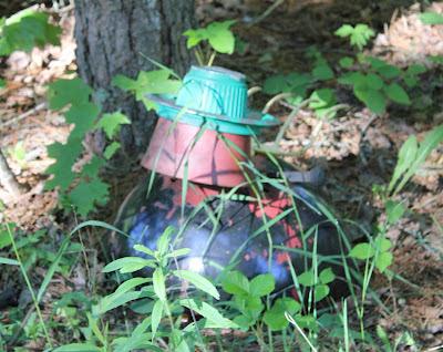 scrap metal lady bug sculpture in the woods