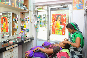 A rural woman at her Beauty Parlor