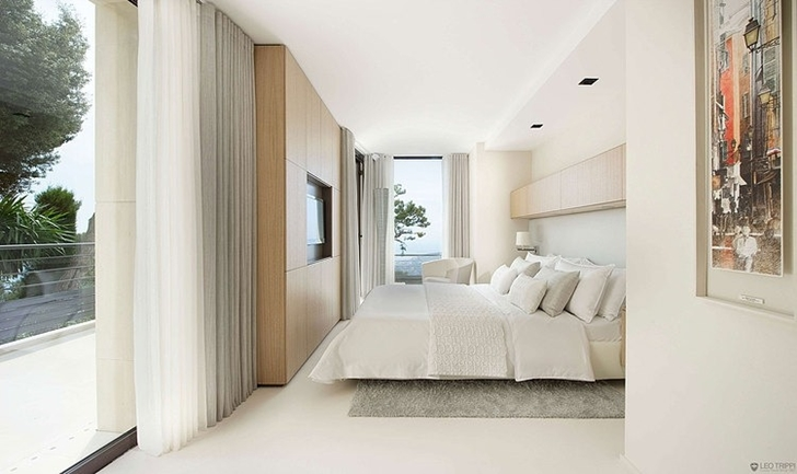 White bedroom in Modern Bayview Villa In French Riviera