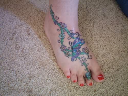 humming bird tattoos hummingbird tattoos with flowers and vines. Black Bedroom Furniture Sets. Home Design Ideas
