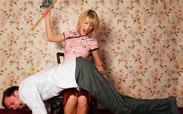 girl spanking man