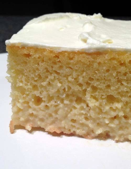 Tres Leches Cake with sweet cream frosting. The cake stays moist by soaking in sweet milk. Sometimes sweet milk saturates the bottom and it tastes soo good! Can be served with cherry or any fruit topping. Plain is delicious, too. Homemade recipe is easy to follow.