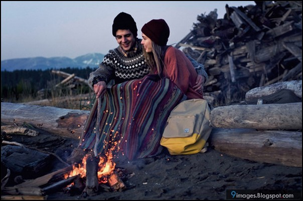 Beach couple cute fire cold weather