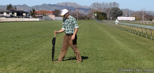 "John Bary, trainer, Havelock North, ""looking for the fast lane"", checking the track condition, at the Hawke's Bay Racing Centre, Hastings Racecourse, Hastings, in preparation for tomorrow's Makfi Challenge Stakes Daffodil Raceday. photograph"
