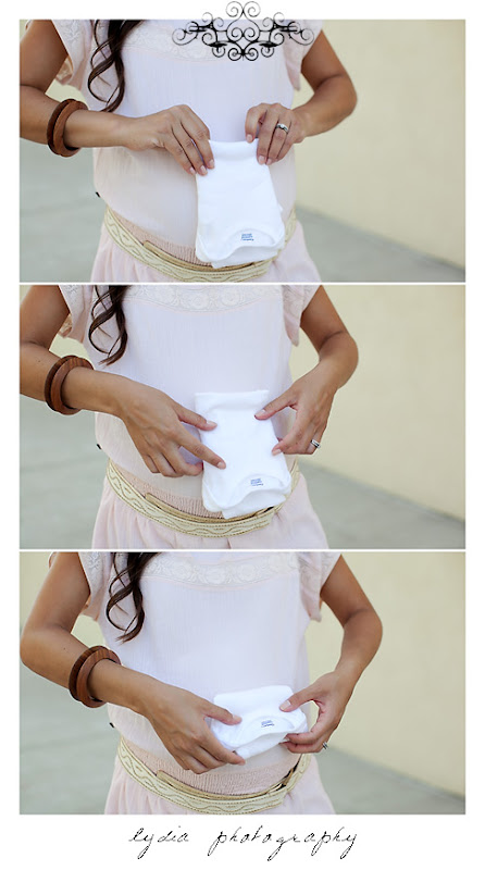 Lifestyle maternity portraits folding onsie at William Jessup University in Rocklin, California