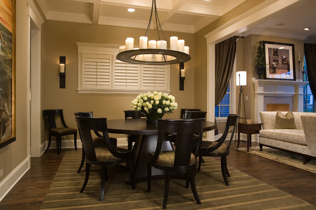 Stunning Dark Round Dining Tables and Dark Chairs under the Ring Iron Chandelier on White Ceiling