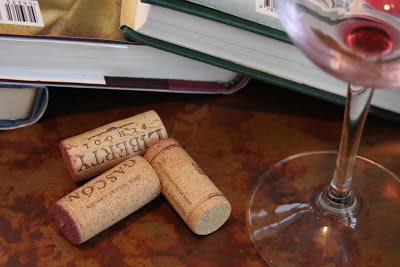 books, corks, empty wine glass