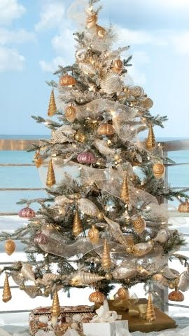 Snow Dusted Christmas Tree with Golden Blown Glass Shell Ornaments ...