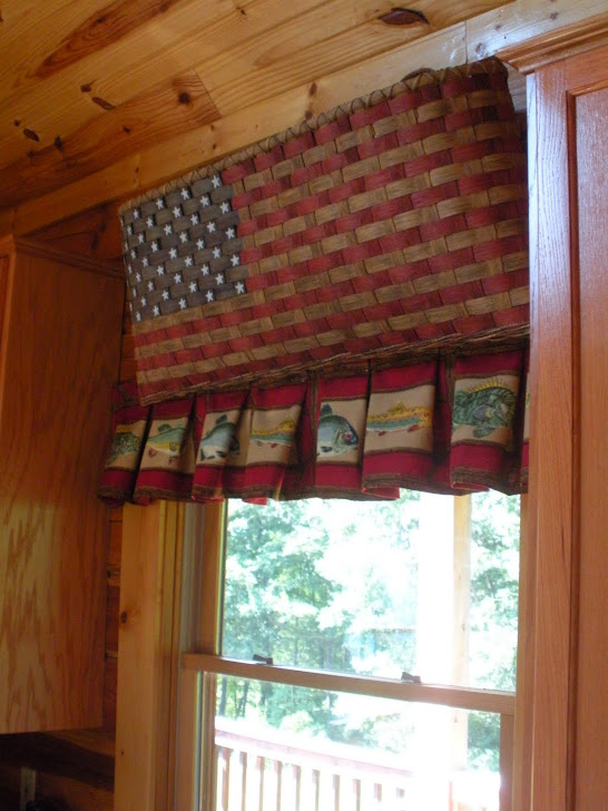 I LOVED THIS LITTLE BASKET HANGING ABOVE THE WINDOW LOOKING OUT TO THE BACK DECK