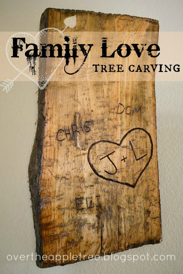 Over the apple tree family love carved