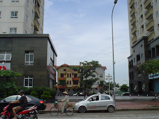 Small family house near the skyscraper Hanoi (Vietnam)