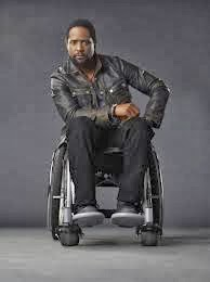 Head on photo of actor Blair Underwood as Ironside, seated in his wheelchair