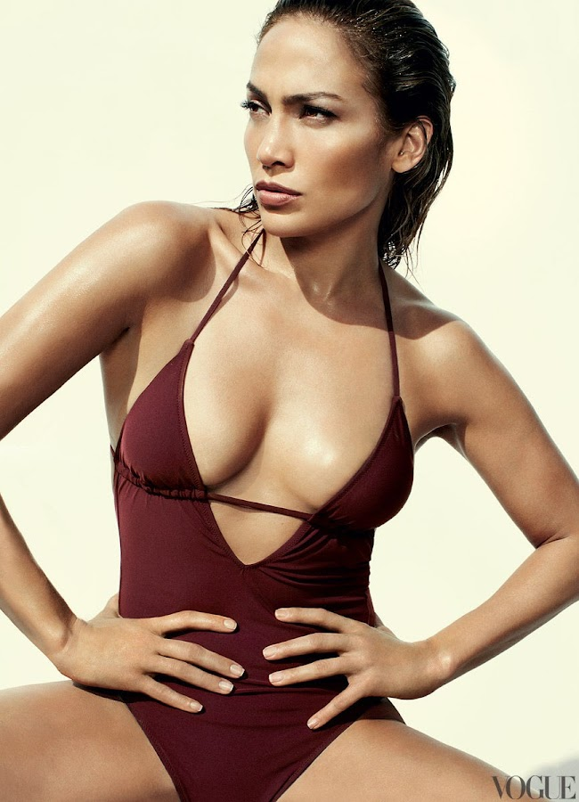 Jennifer Lopez posing in a one piece swimsuit for Vogue magazine