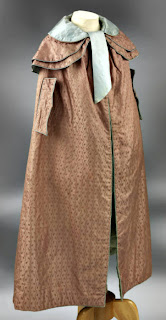 Cloak with capelets, arm slits and piped-bound edgings-side view