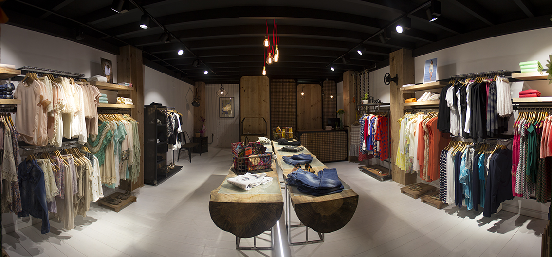 Interiorismo tribeca store que tono de verde for Disenos de tiendas de ropa modernas