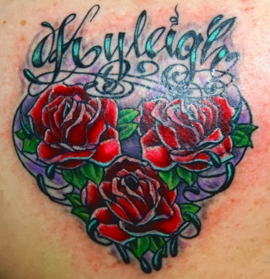 A heart designed with roses. Awesome tattoo.