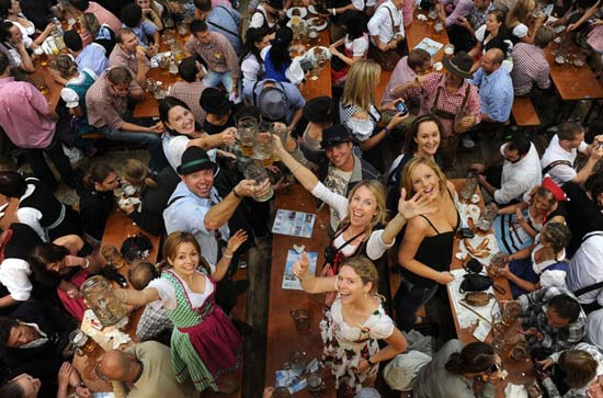 Beer drinking festival at one of the Beer House during Octoberfest Festival in Munich, Germany