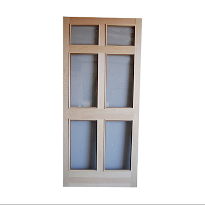 High cotton style the new house a shutter delima for Wood storm doors