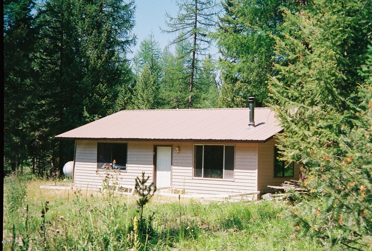 Montana homesteader building a cabin for free part 1 for Building a mountain cabin