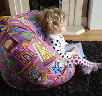 B sitting in the Jacqueline Wilson Bean Bag