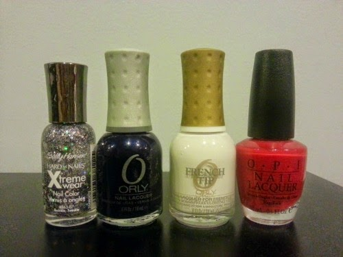 four nail polishes in the colors red white blue and glitter