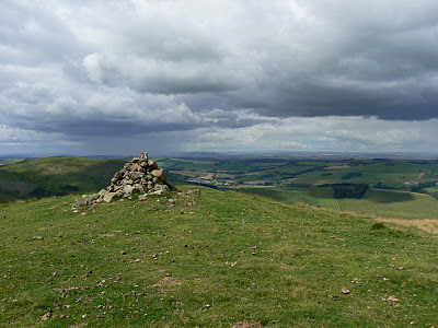 A distant view of the Eildon Hills from Eccles Cairn at the northern end of the Border Ridge