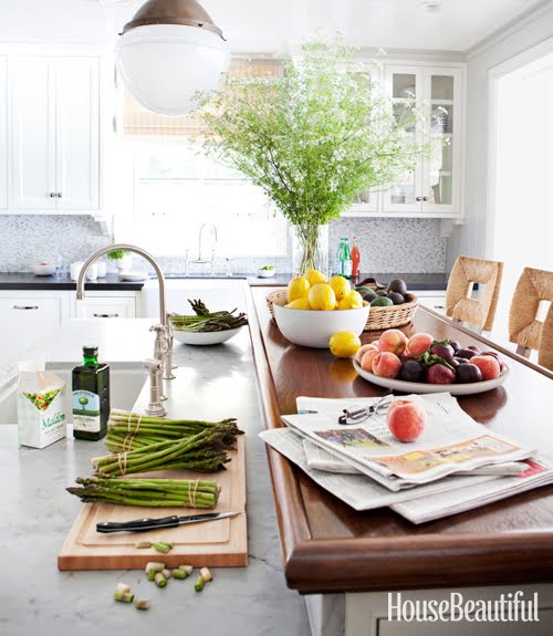 bright and cherry kitchen with assorted fruits and veggies by Peter Dunham