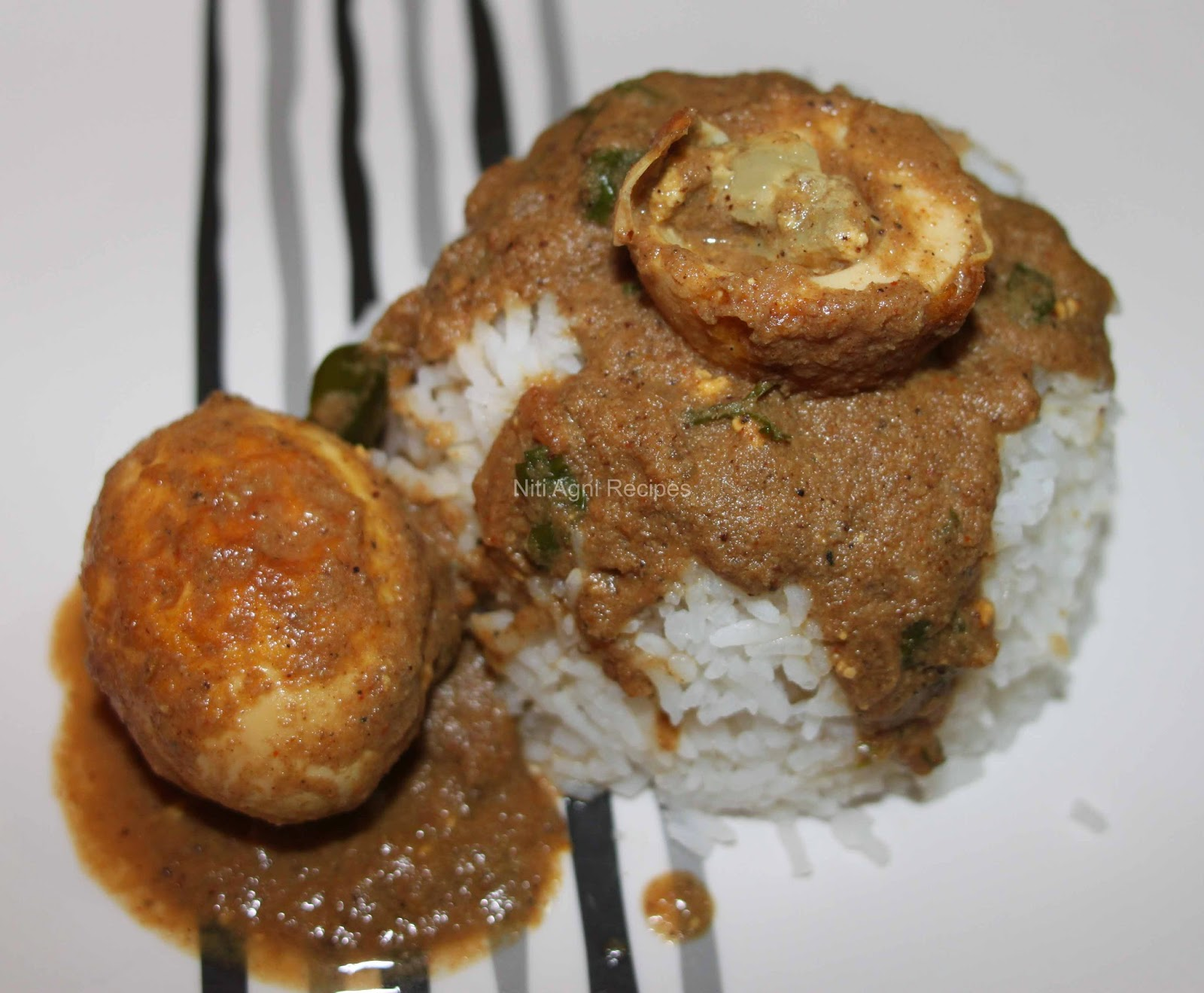 Egg Curry/Anda Curry Made In Coconut Gravy