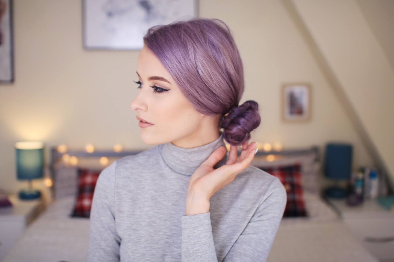 curly low side bun hairstyle