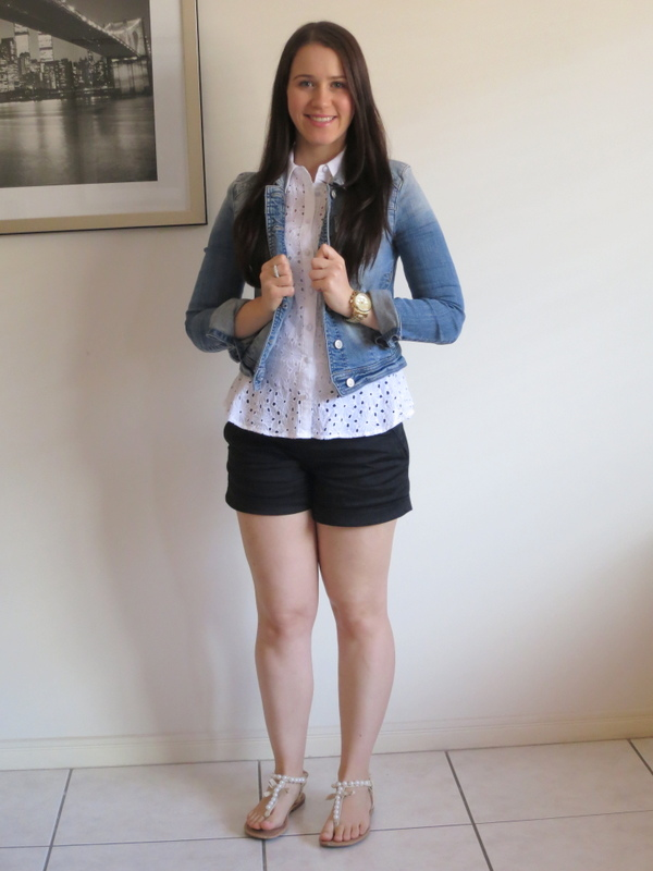 Black shorts, white singlet shirt and denim jacket, with gold jewellery.