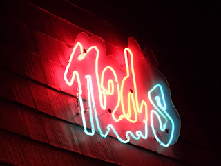 Ned's sign at night