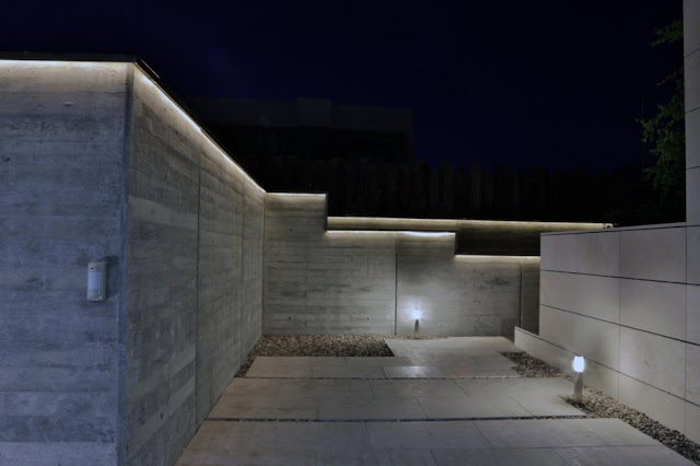 Driveway of The Memory House by A-Cero Architects at night
