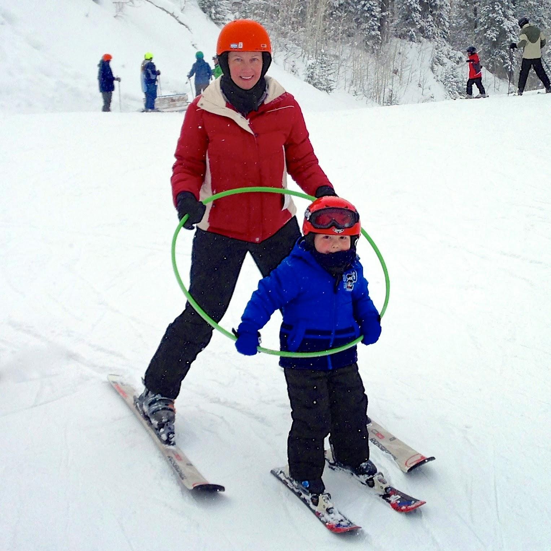 Kate and Jackson skiing with hula hoop