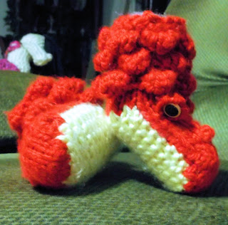 http://www.ravelry.com/patterns/library/crocodile-or-dragon-booties