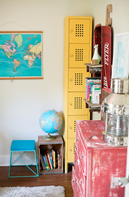 Colorful room with pull-down map, globe, yellow lockers and DIY touches