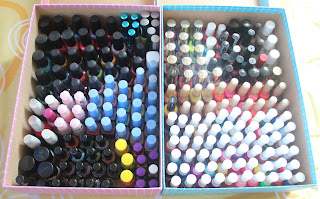 two boxes filled with different nail polish colors