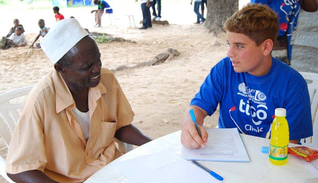 Rotary Club volunteer taking down patient details at Tigo - Rotary Free Medical Camp in Bagamoyo