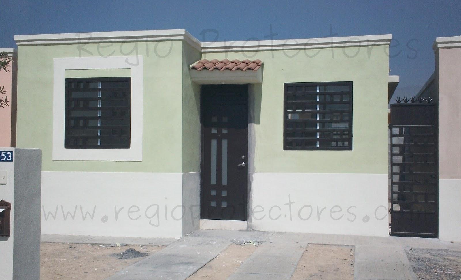 Protectores para ventanas y puerta principal contemporánea instalados ...