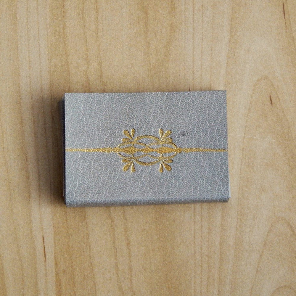 Lizzie made business card cases in leather grey beige soft leather case with silver painted embossed design and blue lokta paper lining reheart Gallery