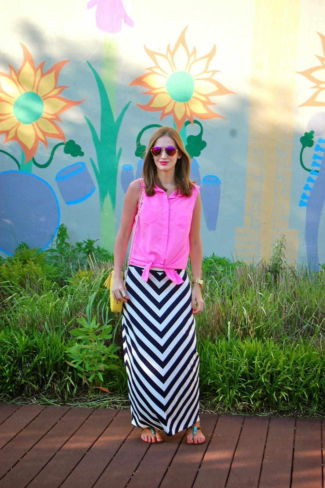 Wearing summer brights, wearing Loft navy striped maxi skirt, hot pink tied blouse, Rebecca Minkoff yellow flirty studded cross body, hot pink mirrored sunglasses