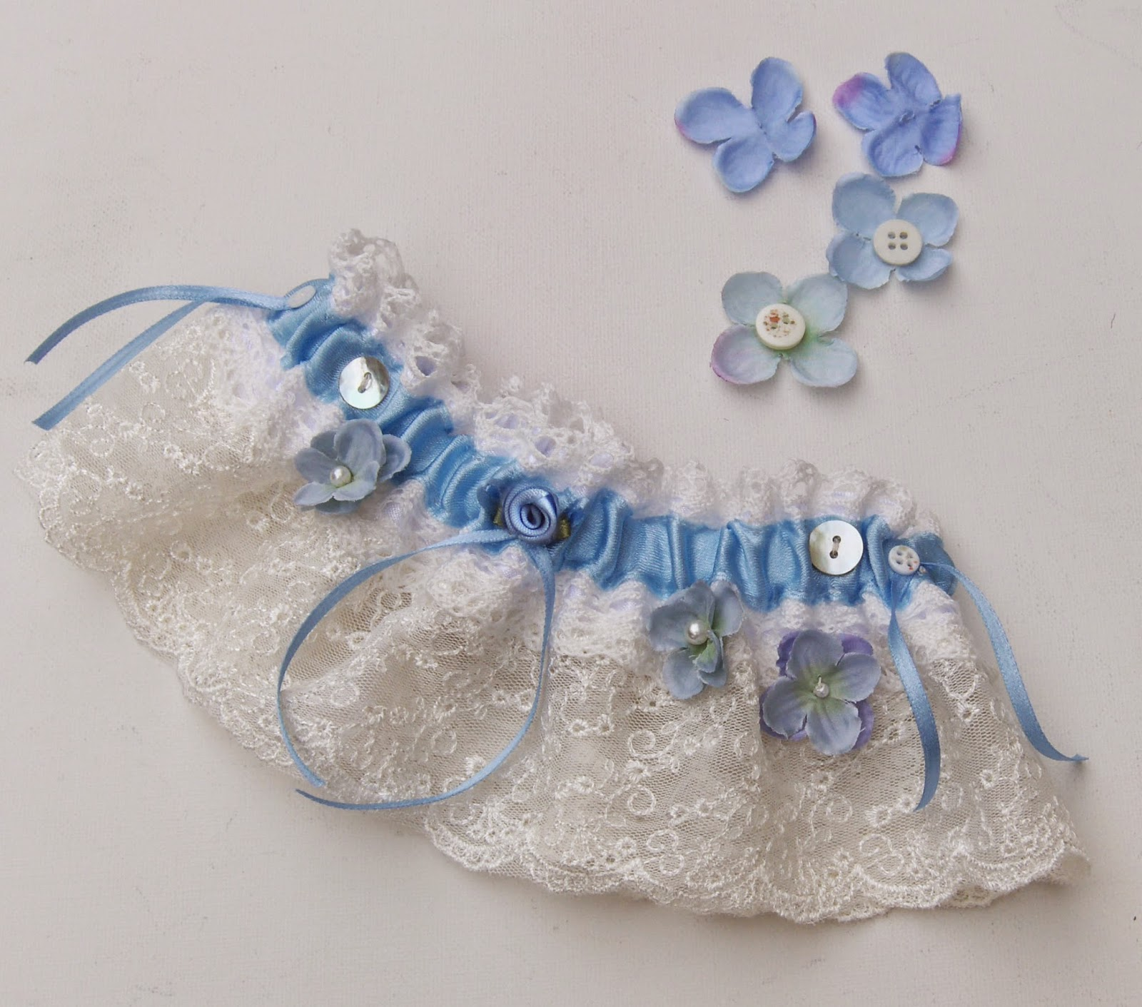 https://www.etsy.com/uk/listing/204198115/bridal-garter-shabby-chic-wedding-blue?ref=shop_home_active_5