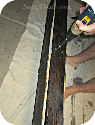 drilling the nail into the wood pallet for the wine rack
