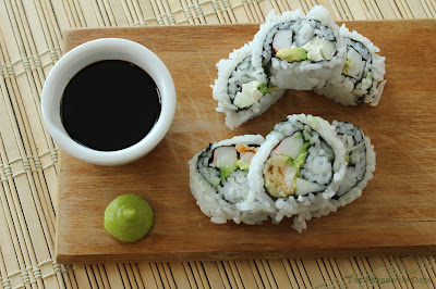 California roll, and a Lisa Lisa roll with soy sauce and wasabi