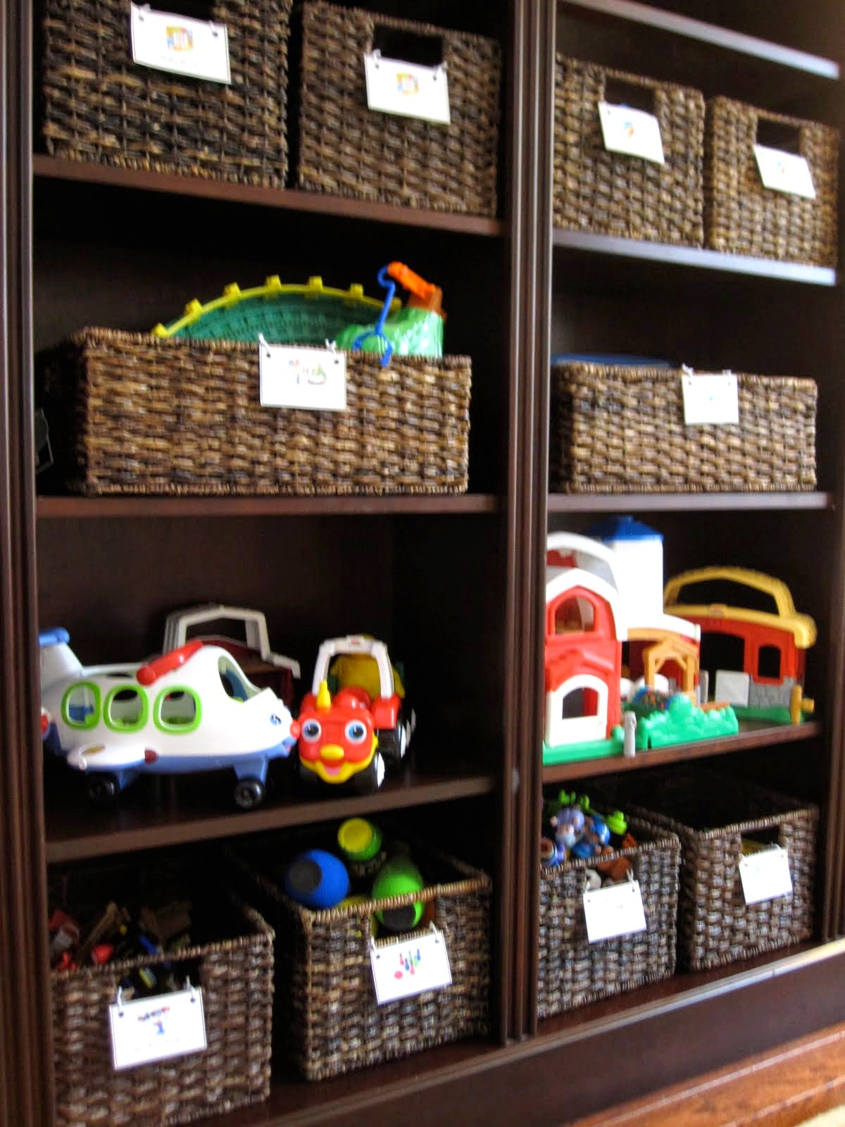 Toddler approved keeping your house organized with kids for Living room storage ideas